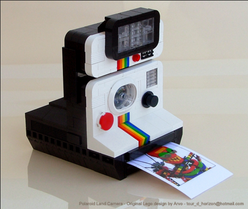 "Image: ""Beautiful Polaroid Camera Sculpted in Lego,"" Wired. The original Polaroid Land Camera processed a photograph instantly, producing one paper copy only per image."